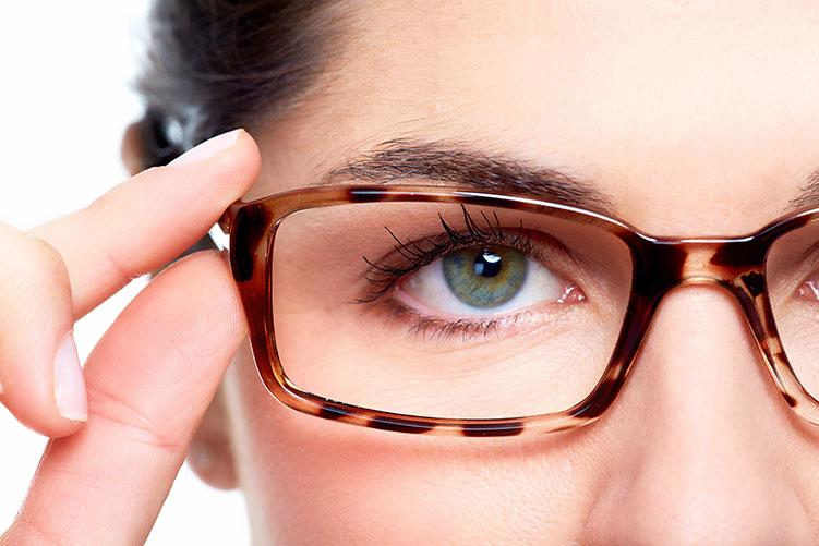 women close up eyeglasses frame