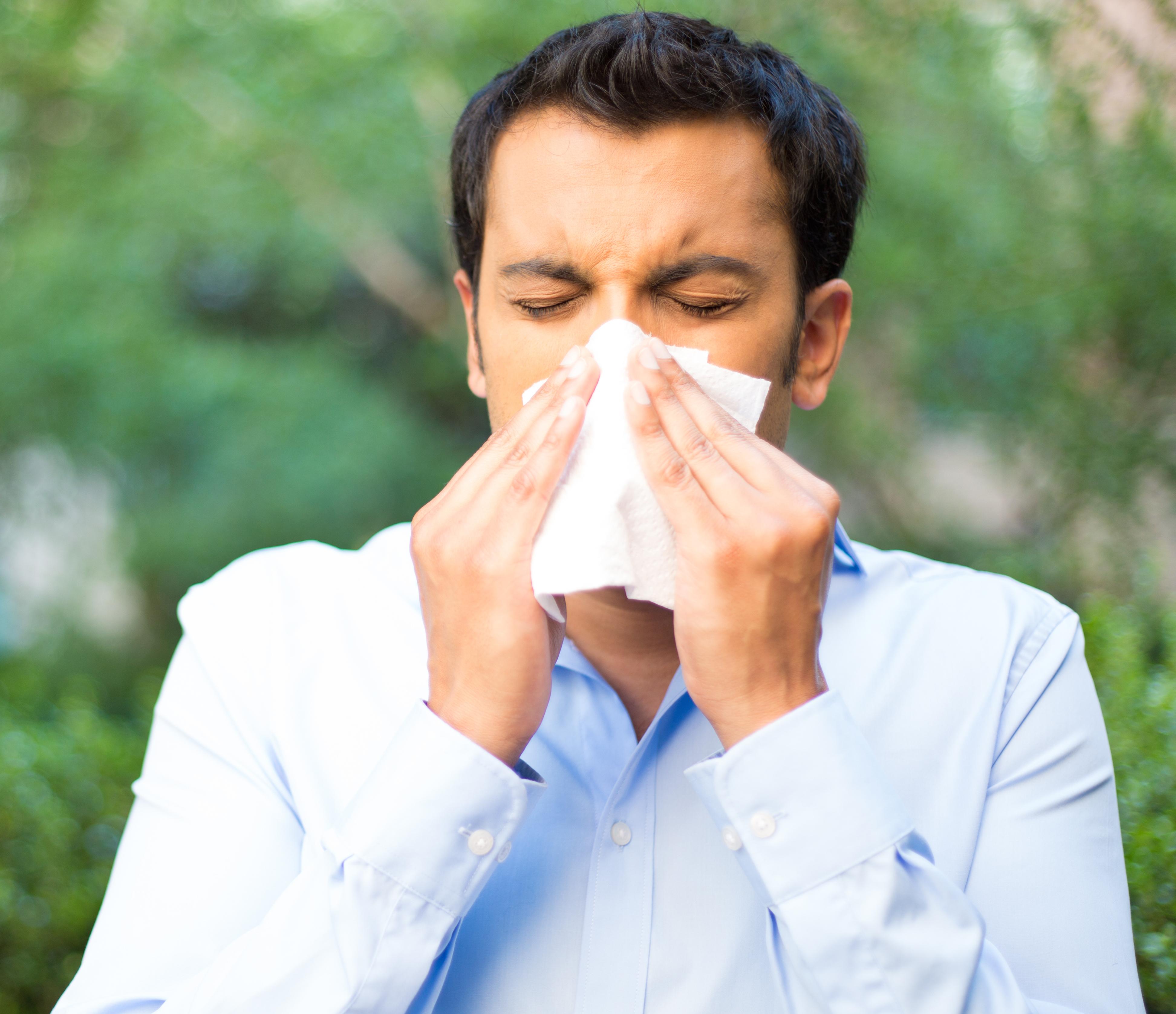 Man dealing with seasonal allergies