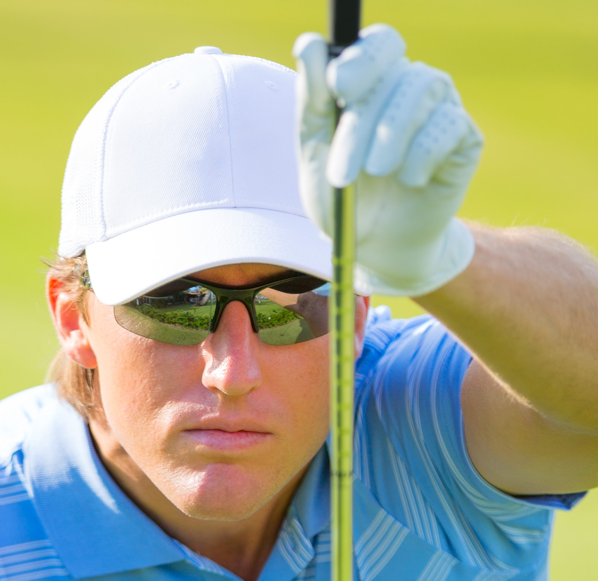Man wearing specialty eyewear while golfing